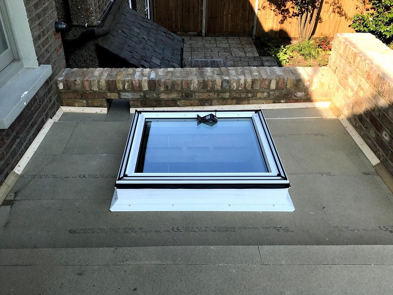 North London roofer fixing flat roof and fitting a skylight