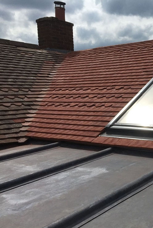 Pitched roof restoration and Velux window fitting in North Londo