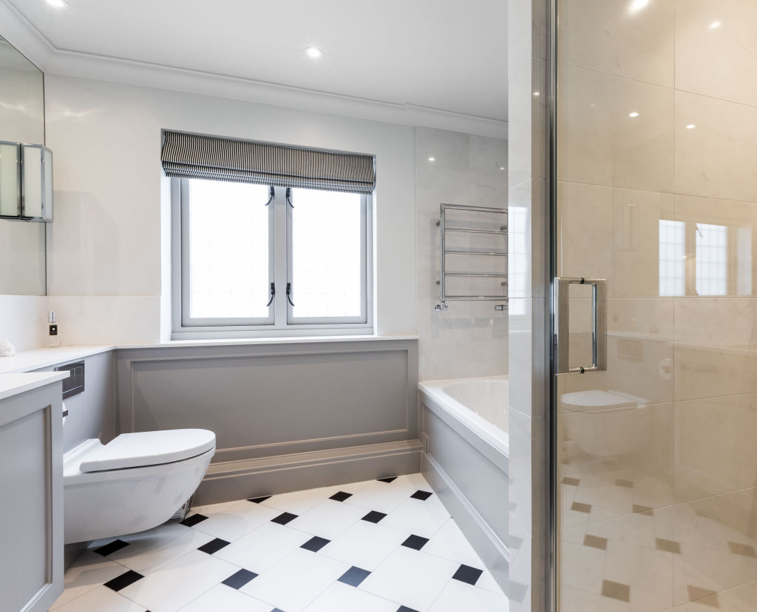 Bathroom tiled with a decorative tile pattern by a North London tiler
