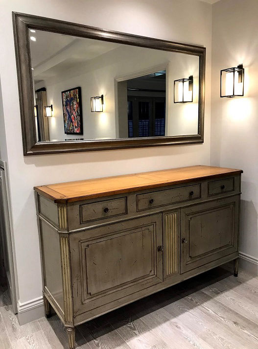 Large mirror hang on the wall by a North London handyman